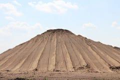 Pile of sand mountain. Pyramidal mountain, pile of sand Royalty Free Stock Photo