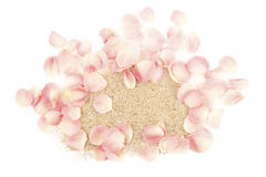 Pile of sand and rose petals Royalty Free Stock Images
