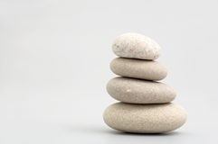 Pile of sand stones. On grey background Stock Photos