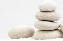 Pile of sand stones in the snow. On grey background royalty free stock photo