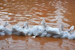 Pile of sandbags in defense from the flood Royalty Free Stock Photography