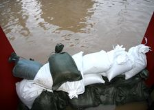 Pile of sandbags in defense from the water. During the flood royalty free stock photos