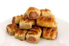 Pile of sausage rolls on a plate Royalty Free Stock Images
