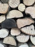 Stack of fire wood background. A pile of sawn logs and wood in a wood store for an environmental background Royalty Free Stock Photo