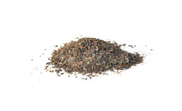 Pile of scattered grains of green tea. On white background Royalty Free Stock Photo