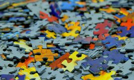 Pile of scattered puzzle pieces. Detail of pile of scattered puzzle pieces Royalty Free Stock Photos