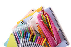 Pile of school books, pencils, pens, equipment and supplies isolated on white background Royalty Free Stock Photography