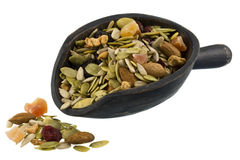 Pile and scoop of healthy trail mix royalty free stock images