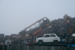 A pile of scrap metal in the fog Stock Photo