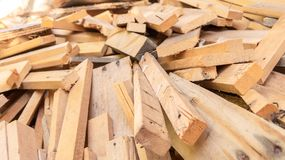 Pile of scrap wood from mattresses and palettes for recycled up-cycled DIY furniture making or wood carpentry projects. Wood