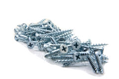 Pile of screws. Pile of metal screws isolated on white background stock photos