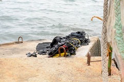 Pile of Scuba Diving Equipment Drying on Dock stock images