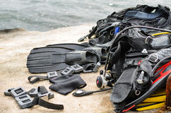 Pile of Scuba Diving Equipment Drying on Dock Stock Photo