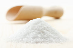 Pile of sea salt on wooden board, scoop Royalty Free Stock Photography