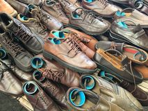 Pile of second hand shoes on shelf. At weekend market Stock Image