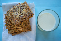 Pile of seed cookies with milk glass Stock Image
