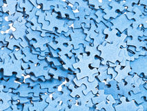 Pile of separated blue puzzle pieces Stock Photos