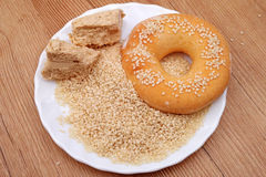 Pile sesame grains, halvah and donut Stock Photos