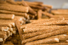Pile of sesame sticks. Close up photo of lots of sesame sticks in a pile in a counter of a shop Stock Photography