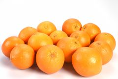Pile, set of oranges, bright shiny orange, close-up on a white background, top empty place for text. Pile, set of oranges, bright shiny orange, closeup on a Stock Photography
