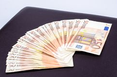 Pile of 50 Euro banknotes. Pile of several 50 euro banknotes on leather background stock image