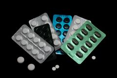 Pile of several medicines on black background.  Stock Photography