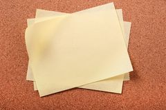 Pile several untidy yellow post notes cork notice board background royalty free stock images