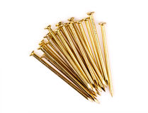 Pile of sharp brass nails Stock Photography