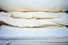 A pile of sheets inside a linen closet stock images