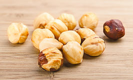 A pile of shell-less hazelnuts, isolated on textural wood backgr Royalty Free Stock Photo