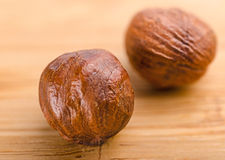 A pile of shell-less hazelnuts, isolated on textural wood backgr Stock Photos