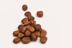 Hazelnuts on a white background. A pile of shelled hazelnuts on a white background Stock Photo