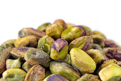 Pile of Shelled Pistachio Nuts over White Royalty Free Stock Images