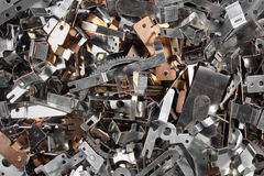 Pile of shiny metal parts. Scrap steel details as abstract industrial texture Royalty Free Stock Image