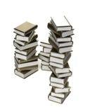 Pile of shiny stylized golden books. Isolated on white Royalty Free Stock Photo