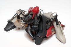Pile of shoes. Pile of different shoes isolated on white Royalty Free Stock Images