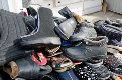 Pile of shoes at the counter on the market Royalty Free Stock Photo