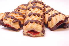 Pile of shortbread cookies with jam and chocolate icing Stock Photos