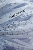 Pile of shredded paper - confidential. Shredded paper series - focus on word 'confidential Royalty Free Stock Image