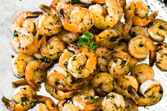 Pile Of Shrimp Seafood Appetizer Dinner On Metal Pan. Shrimp piled up on metal pan for appetizer or dinner with parsley sprig Royalty Free Stock Photography