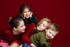 Pile Of Siblings On Red Royalty Free Stock Photo