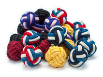Pile of silk knot cuff links Stock Image