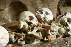 Pile of skulls by the entrance to TampangAllo burial cave in Tana Toraja. Indonesia Stock Image