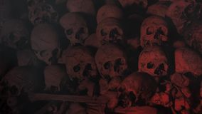 Pile of Skulls with Smoke Sparks and Red Lights 4K Loop. Features a pile of old cracked skulls and bones with smoke and sparks flying across the scene and stock footage