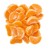 Pile of slice sections of tangerine isolated over. Pile of slice sections of fresh tangerine isolated over the white background Royalty Free Stock Photography