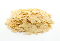 Pile of sliced almonds on white background Stock Photos