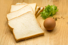 Pile of sliced bread, egg and vegetable Stock Images