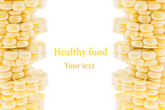 Pile of sliced corn cobs on a white background. Isolated. Decorative frame. Macro. Food background. Copy space. Stock Images
