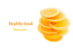 Pile of slices of sliced oranges on a white background. Isolated. Copy space. Fruit background. Royalty Free Stock Image