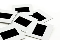Pile of slides with frames on llightbox. Royalty Free Stock Images
